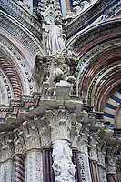 Detail of columns arches and statues Duomo di Siena Siena Italy