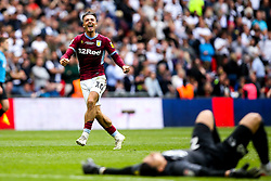 Jack Grealish of Aston Villa celebrates winning promotion to the Premier League after beating Derby County in the Sky Bet Championship Playoff Final as Kelle Roos of Derby County lies on the floor dejected - Mandatory by-line: Robbie Stephenson/JMP - 27/05/2019 - FOOTBALL - Wembley Stadium - London, England - Aston Villa v Derby County - Sky Bet Championship Play-off Final