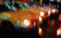 USA, New York City, Times Square, taxis in foreground (blurred motion)