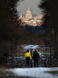 © Licensed to London News Pictures. 28/02/2018. Richmond upon Thames, UK. After a day of heavy snow showers, a couple look at St Paul's bathed in a burst of sunshine from 10 miles away in Richmond Park. Further disruption is expected today as the so called Beast from the East weather front continues to affect the UK. Photo credit: Peter Macdiarmid/LNP