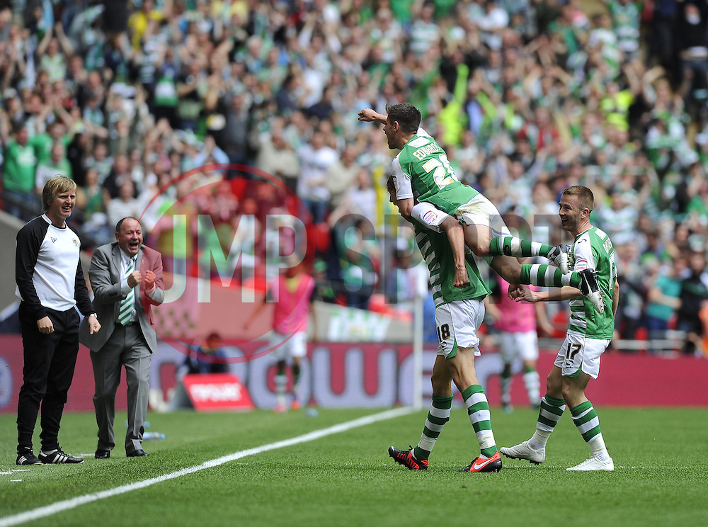 Yeovil Town's Paddy Madden celebrates Yeovils second goal with Yeovil Town's Dan Burn , Yeovil Town's Joe Edwards and Yeovil Town Manger, Gary Johnson- Photo mandatory by-line: Joe Meredith/JMP - Tel: Mobile: 07966 386802 19/05/2013 - SPORT - FOOTBALL - LEAGUE 1 - PLAY OFF - FINAL - Wembley Stadium - London - Brentford V Yeovil Town