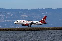 Airbus A319-112 (N529VA) operated by Alaska Airlines landing at San Francisco International Airport (KSFO), San Francisco, California, United States of America