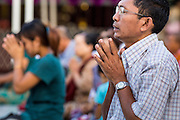15 JUNE 2013 - YANGON, MYANMAR:  A man prays at Shwedagon Pagoda. Shwedagon Pagoda is officially known as Shwedagon Zedi Daw and is also called the Great Dagon Pagoda or the Golden Pagoda. It is a 99 meter (325 ft) tall pagoda and stupa located in Yangon, Burma. The pagoda lies to the west of on Singuttara Hill, and dominates the skyline of the city. It is the most sacred Buddhist pagoda in Myanmar and contains relics of the past four Buddhas enshrined: the staff of Kakusandha, the water filter of Koṇāgamana, a piece of the robe of Kassapa and eight strands of hair from Gautama, the historical Buddha. Burmese believe the pagoda was established as early ca 540BC, but archaeological suggests it was built between the 6th and 10th centuries. The pagoda has been renovated numerous times through the centuries. Millions of Burmese and tens of thousands of tourists visit the pagoda every year, which is the most visited site in Yangon. PHOTO BY JACK KURTZ