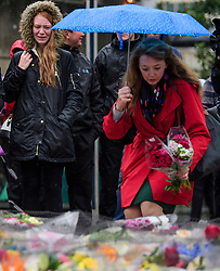 © Licensed to London News Pictures. 06/06/2017. London, UK.  Flowers being placed following a minutes silence at London Bridge in central London for those who lost their life in a terrorist attack on Saturday evening. Three men attacked members of the public  after a white van rammed pedestrians on London Bridge.   Ten people including the three suspected attackers were killed and 48 injured in the attack. Photo credit: Ben Cawthra/LNP