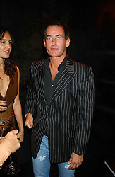 TIM JEFFERIES at a party to celebrate the first 20 years of fashion label Donna Karan held at her store at 19/20 New Bond Street, London W1 on 21st September 2004.<br />