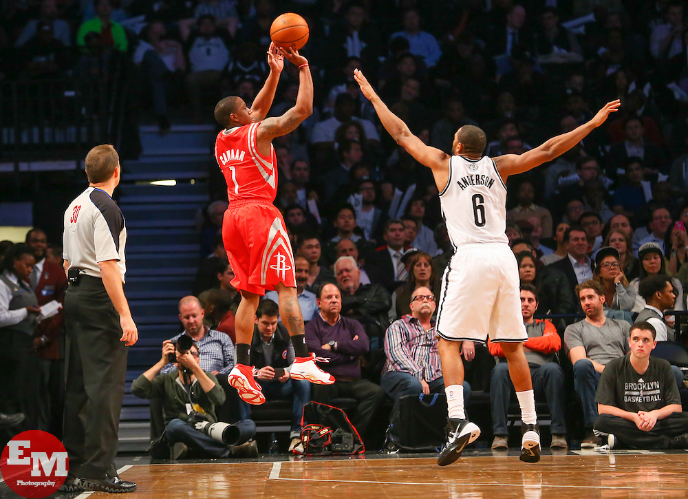 Apr 1, 2014; Brooklyn, NY, USA; Houston Rockets guard Isaiah Canaan (1) shoots the ball over Brooklyn Nets forward Alan Anderson (6) during the fourth quarter at Barclays Center. The Nets defeated the Rockets 105-96.