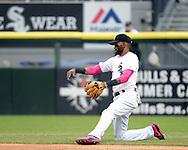 CHICAGO - MAY 10:  Alexei Ramirez #10 of the Chicago White Sox fields against the Cincinnati Red on May 10, 2015 at U.S. Cellular Field in Chicago, Illinois.  (Photo by Ron Vesely)   Subject:   Alexei Ramirez