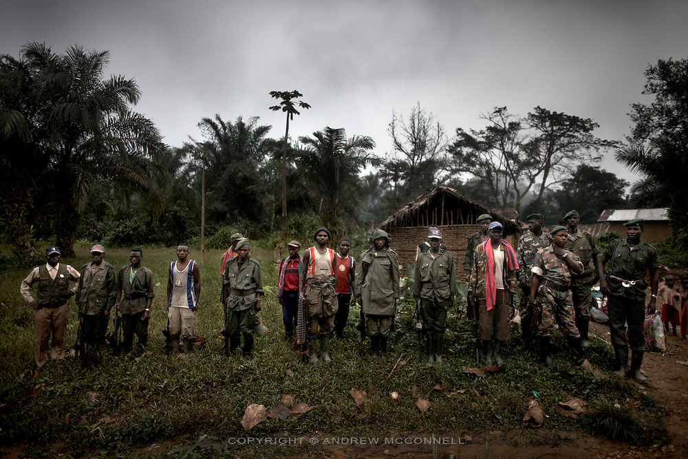 FDLR soldiers at a jungle camp on the North/South Kivu border, DRC, on Sunday, March. 16, 2008..The FDLR comprises Hutu extremists who fled Rwanda after their involvement in the 1994 genocide, as well as Hutu members of the former Rwandan army and a mix of displaced Rwandan Hutus. Numbering approximately 10,000, they have lived in the jungles of DRC for the past 14 years and in that time have resisted repeated calls for disarmament and repatriation..