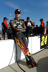 Jeff Gordon waits for qualifying to begin for a NASCAR Sprint Cup series auto race, Friday, May 9, 2014, at Kansas Speedway in Kansas City, Kan. (AP Photo/Colin E. Braley)