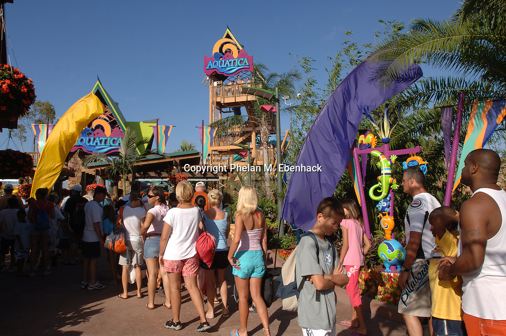 Park guests wait to enter Sea World's new waterpark Aquatica in Orlando, Florida.