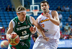 Miha Zupan of Slovenia vs Felipe Reyes of Spain during the fifth-place basketball match between National teams of Slovenia and Spain at 2010 FIBA World Championships on September 10, 2010 at the Sinan Erdem Dome in Istanbul, Turkey.   (Photo By Vid Ponikvar / Sportida.com)