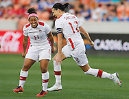 Feb 19, 2016; Houston, TX, USA; Canada forward Christine Sinclair (12)  reacts after scoring her second goal of the night against Costa Rica in the second half during the semifinals of the 2016 CONCACAF women's Olympic soccer tournament at BBVA Compass Stadium. Canada won 3 to 1. Mandatory Credit: Thomas B. Shea-USA TODAY Sports