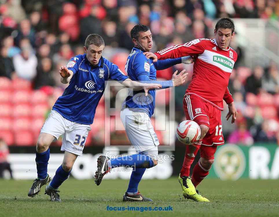 Picture by Paul Gaythorpe/Focus Images Ltd +447771 871632.16/03/2013.Shane Ferguson and Paul Robinson of Birmingham City and Lukas Jutkiewicz of Middlesbrough during the npower Championship match at the Riverside Stadium, Middlesbrough.