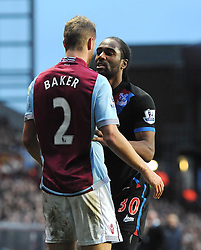 Crystal Palace's Cameron Jerome squares up tp Aston Villa's Nathan Baker - Photo mandatory by-line: Joe Meredith/JMP - Tel: Mobile: 07966 386802 26/12/2013 - SPORT - FOOTBALL - Villa Park - Birmingham - Aston Villa v Crystal Palace - Barclays Premier League