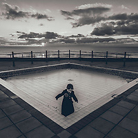 Child in a paddling pool in winter
