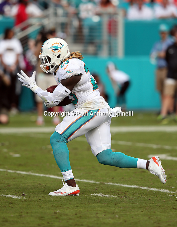 Miami Dolphins running back Jay Ajayi (23) runs the ball during the 2015 week 13 regular season NFL football game against the Baltimore Ravens on Sunday, Dec. 6, 2015 in Miami Gardens, Fla. The Dolphins won the game 15-13. (©Paul Anthony Spinelli)