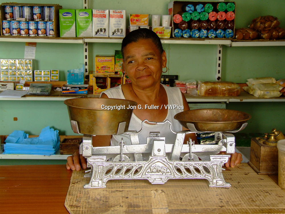 Shopkeeper in a small, traditional neighborhood market in Ponta do Sol, Santo Antao, Republic of Cabo Verde, Africa.