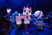 UNITED KINGDOM, London: 25 May 2019 <br /> A cosplay competitor dressed as Princess Unikitty from The LEGO Movie waits in line backstage before competing in the Championships of Cosplay during the MCM London Comic Con. The three day comic convention is being held at London ExCeL from Fri 24th - Sun 26th of May.