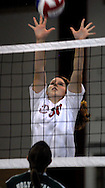 10 DEC. 2010 -- ST. LOUIS -- Assumption School volleyball players Kristina Eason (30) attempts to block a shot from Holy Infant School during the championship match of the CYC girls' parochial closed division tournament at the Monsignor Meyer Youth Center in St. Louis Friday Dec. 10, 2010.  Image © copyright 2010 Sid Hastings.