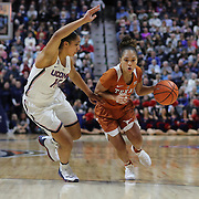 UNCASVILLE, CONNECTICUT- DECEMBER 4: Brooke McCarty #11 of the Texas Longhorns drives past Gabby Williams #15 of the Connecticut Huskies during the UConn Huskies Vs Texas Longhorns, NCAA Women's Basketball game in the Jimmy V Classic on December 4th, 2016 at the Mohegan Sun Arena, Uncasville, Connecticut. (Photo by Tim Clayton/Corbis via Getty Images)