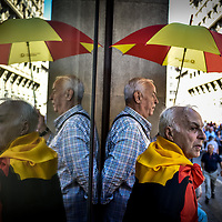 Barcelona, Spain - 8 October 2017: Two men look at demonstrators during the Pro unity rally against Catalonian Independence