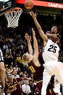 February 16th, 2013 Boulder, CO - Colorado Buffaloes sophomore guard Spencer Dinwiddie (25) is mugged by Arizona State Sun Devils senior forward/guard Carrick Felix (0) during a shot attempt in overtime of the NCAA basketball game between the Arizona State Sun Devils and the University of Colorado Buffaloes at the Coors Events Center in Boulder CO