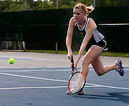 Prairie's April McKeever, senior, runs up on the ball as she tries to return it to Xavier's Lisa Cowden (not pictured) during their match in the 1st round of the Regional Tennis Tournament at Xavier High School in Cedar Rapids on Saturday, May 15, 2010. Cowden defeated McKeever 6-0, 6-1 and Xavier defeated Prairie 5-0.