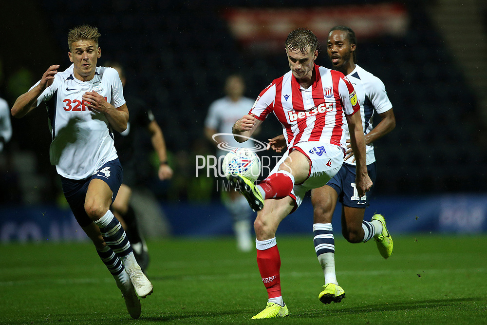 Stoke City defender Liam Lindsay (5) clears the danger from Preston North End midfielder Brad Potts (44) during the EFL Sky Bet Championship match between Preston North End and Stoke City at Deepdale, Preston, England on 21 August 2019.