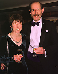 MRS MARGARET COOK, former wife of Foreign Secretary Robin Cook and her close friend MR ROBIN HOWIE, at a party in London on 4th February 1999.MNZ 5