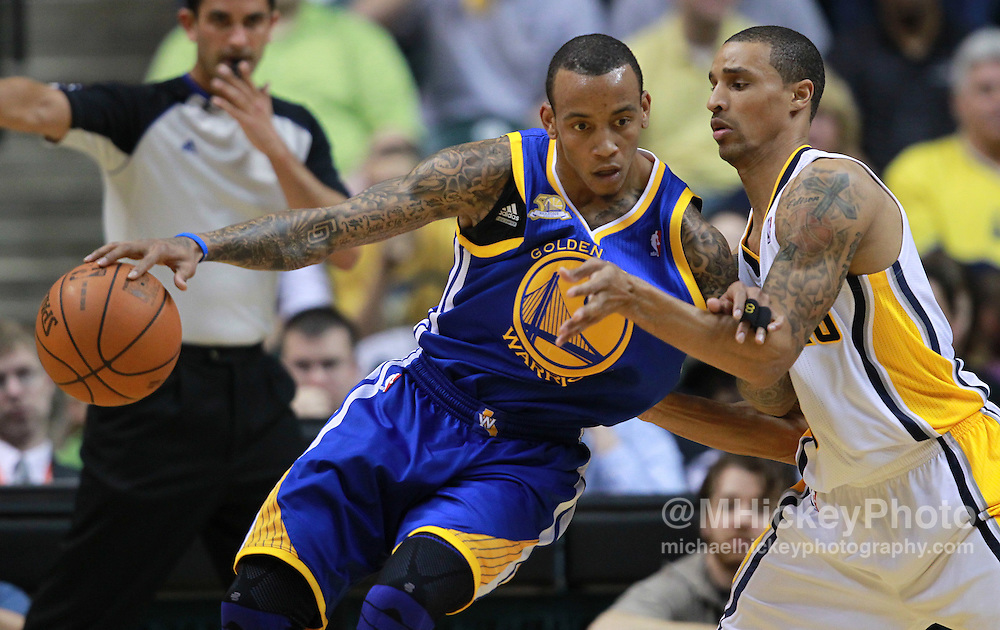 Feb. 28, 2012; Indianapolis, IN, USA; Golden State Warriors shooting guard Monta Ellis (8) drives the ball Indiana Pacers shooting guard George Hill (3) at Bankers Life Fieldhouse. Mandatory credit: Michael Hickey-US PRESSWIRE