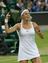 LONDON, ENGLAND - Tuesday, June 28, 2011: Victoria Azarenka (BLR) celebrates after winning the Ladies' Singles Quarter-Final match on day eight of the Wimbledon Lawn Tennis Championships at the All England Lawn Tennis and Croquet Club. (Pic by David Rawcliffe/Propaganda)