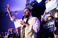 """Naples, Italy - People attend the conference of Lega Nord party leader matteo Salvini in Naples. Napoli, Italia - Matteo Salvini durante il suo comizio alla Mostra D'Oltremare a Napoli. La sala era gremita di supporters del leader leghista provenienti dal sud e dal nord Italia. Salvini ha detto: """"anche Napoli è casa mia dal palco"""". Il leader della Lega Nord e candidato premiere ha più volte, in passato, usato termini dispregiativi nei confronti di Napoli ed del sud Italia."""
