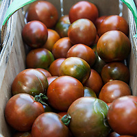 A basket of 'Cuban Small' heirloom tomatoes
