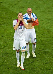 MOSCOW, RUSSIA - Sunday, July 1, 2018: Russia's Artem Dzyuba and team-mate Fedor Kudriashov (right) celebrate after beating Spain 4-3 on penalties during the FIFA World Cup Russia 2018 Round of 16 match between Spain and Russia at the Luzhniki Stadium. (Pic by David Rawcliffe/Propaganda)