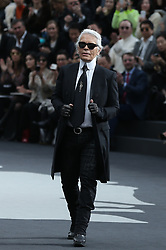 Designer Karl Lagerfeld appears on the catwalk at the end of his collection show for fashion house Chanel as part of the Fall-Winter 2013/2014 Ready-to-Wear Paris Fashion Week, at Grand Palais in Paris, France on March 5, 2013. Photo by Frederic Nebinger/ABACAPRESS.COM