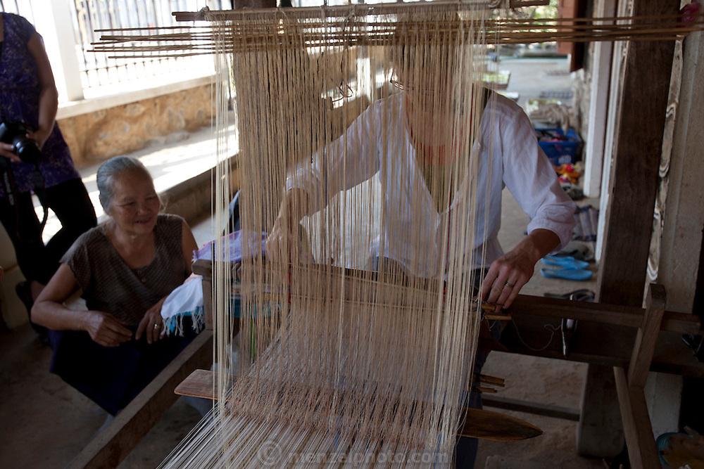 Weaver at Ban Pha Nom, near Luang Prabang, Laos.