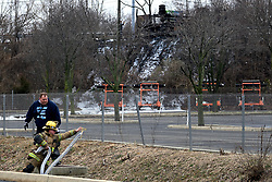 Firefighters of local fire fighting companies remain on the scene to deal with the aftermath of a Class B tanker fire at an off ramp of the Interstate I-95, in Bensalem Township, Pennsylvania, on February 7, 2019. Aqueous film forming foams (AFFF) used in fighting fires of flammable liquids or flammable gases, oils, solvents and alcohols can contain sodium alkyl sulfate, fluorotelomers, perfluorooctanoic acid (PFOA) or perfluorooctanesulfonicacid (PFOS).<br /> The United States Environmental Protection Agency (EPA) is expected to release updates on tests of per- and polyfuoroalkyl substances or PFAs pollution in public water supplies for 16 million Americans in 33 states, including Pennsylvania. The federal report is delayed due to January 2019 shutdown. Reps. Brian Fitzpatrick, Republican of Bucks County in Eastern Pennsylvania and Democrat Dan Kildee, of Michigan cochair a bipartisan task force in the House of Representatives, formed to take on the growing PFAS Contamination Crisis. The usage of foam at nearby former military bases is linked to tainted drinking water, affecting tens of thousands of residents in Bucks and Montgomery Counties in Eastern Pennsylvania.