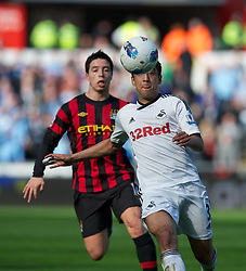 SWANSEA, WALES - Sunday, March 11, 2012: Swansea City's Neil Taylor in action against Manchester City during the Premiership match at the Liberty Stadium. (Pic by David Rawcliffe/Propaganda)