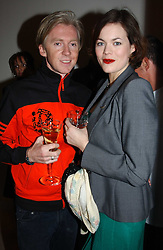 Milliner PHILIP TREACY and  JASMINE GUINNESS at a party to celebrate the opening of Jasper Conran's new shop and HQ at 36 Sackville Street, London W1 on 15th February 2005.<br />
