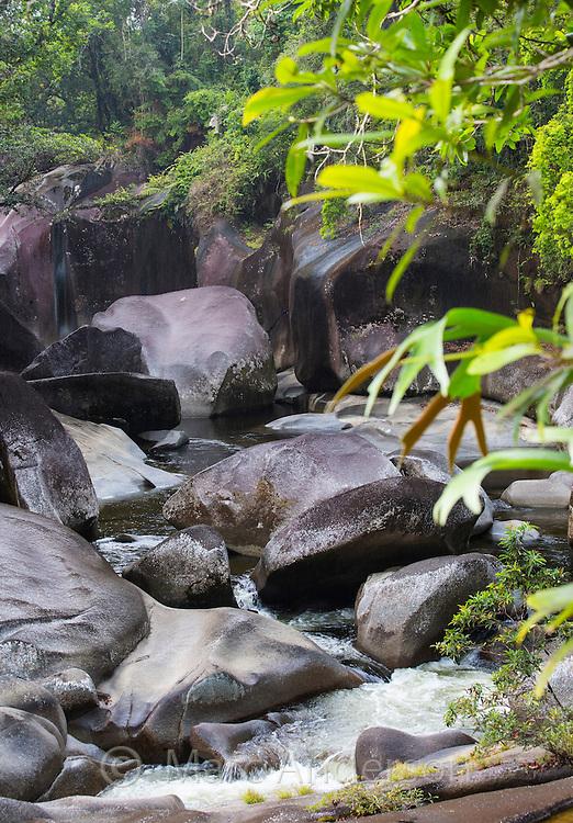 Granite boulders and river bed surrounded by tropical rainforest. Located near Babinda, Wooroonooran National Park, Queensland, Australia