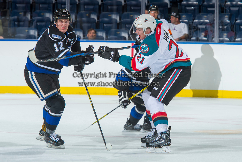 KELOWNA, CANADA - SEPTEMBER 2: Defenseman Kyle Pow #21 of the Kelowna Rockets passes the puck ahead of right wing Spencer Gerth #12 of the Victoria Royals on September 2, 2017 at Prospera Place in Kelowna, British Columbia, Canada.  (Photo by Marissa Baecker/Shoot the Breeze)  *** Local Caption ***