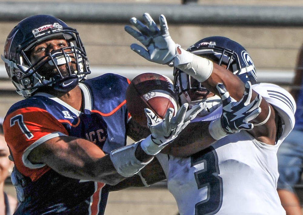 11/5/16 2:47:39 PM Orange Coast Pirate wide receiver Robert Thomas (7) and Fullerton Hornet defensive back D'Angelo Ross (3) battle for the ball during the third quarter. Fullerton College v Orange Coast College Football, at LeBard Stadium on the campus of Orange Coast College in Costa Mesa, CA<br /> <br /> Photo by Joshua D. McKee