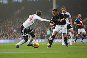 Fulham striker Sone Aluko (24) taking on Derby County defender Marcus Olsson (29) during the EFL Sky Bet Championship match between Fulham and Derby County at Craven Cottage, London, England on 17 December 2016. Photo by Matthew Redman.