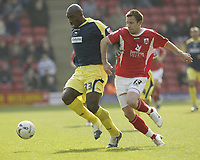 Photo: Aidan Ellis.<br /> Barnsley v Derby County. Coca Cola Championship. 31/03/2007.<br /> Derby's Darren Moore (L) and Barmnsley's Peter Rajczi
