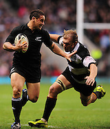 London - Saturday, December 5th 2009: Cory Jane of New Zealand and Schalk Burger of Barbarians during the game at Twickenham, London. ..(Pic by Alex Broadway/Focus Images)