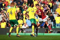 Nathan Baker of Bristol City challenges Cameron Jerome of Norwich City - Mandatory by-line: Robbie Stephenson/JMP - 23/09/2017 - FOOTBALL - Carrow Road - Norwich, England - Norwich City v Bristol City - Sky Bet Championship