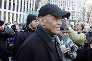 Singer and activist Harry Belefonte participates in a  silent march down Fifth Avenue  ''to shop for justice,'' in the police shooting incident that killed Sean Bell and wounded two of his friends on his wedding day in New York, December 16, 2006. .Photo by Keith Bedford<br />