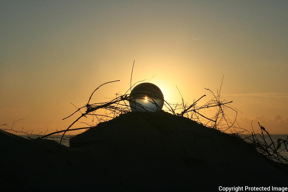 crystal ball on bank near Jekyll Island beach at sunrise