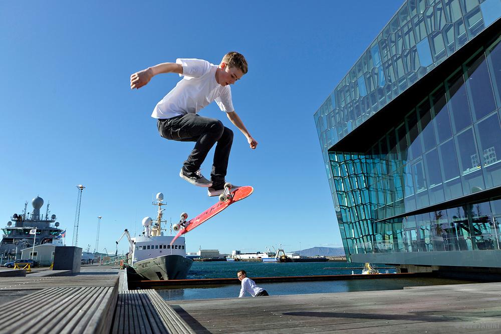 Skater, Harpa Concert Hall and Conference centre building placed at the  Reykjavik harvour, Iceland.
