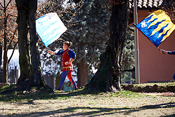 Local performers march with flags to sign on at Trofeo Alfredo Binda 2019, a 131.1 km road race from Taino to Cittiglio, Italy on March 24, 2019. Photo by Sean Robinson/velofocus.com